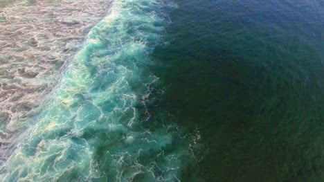 Flying-Over-Turquoise-Blue-Indonesian-Ocean