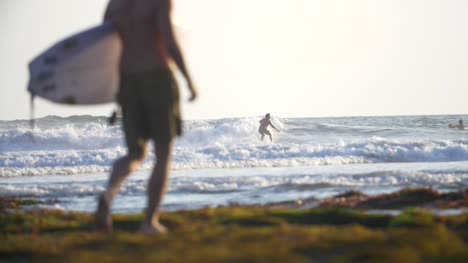 Slow-Motion-Surfers-on-a-Beach
