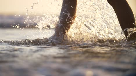 Walking-Through-Surf-and-Kicking-Up-Spray