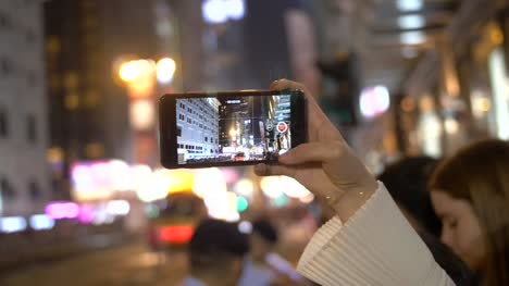 Person-Filming-Parade-on-Smartphone