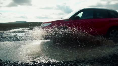 Car-Driving-Through-Puddle-In-Slow-Motion