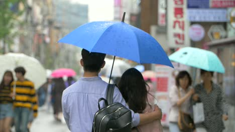 Couple-Sharing-Blue-Umbrella
