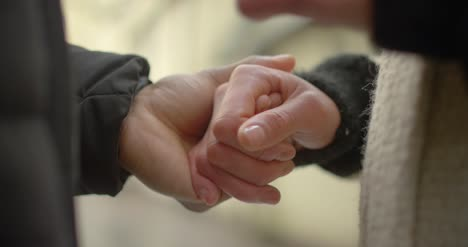 Couple-Holding-Hands-Close-Up