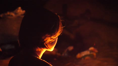Young-Woman-Looking-into-Fire