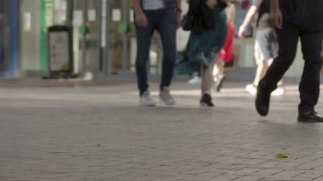 Defocused-Shot-of-Feet-Walking-In-Busy-Road-In-Birmingham